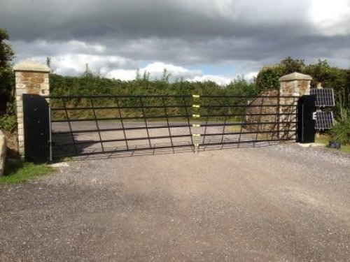 Vertical Lifting Gates for Sloping Driveways